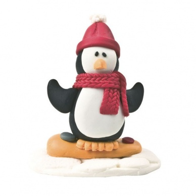Snowboarding penguin claydough cake topper